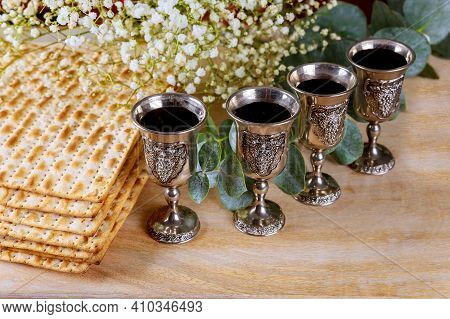 Wine With Kosher Four Glasses Of Matzah A Passover Haggadah On A Vintage Wood Background