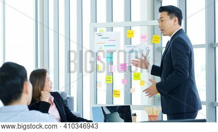 Business Meeting For Presenting Business Plan Information At Office, Asian Man Explaning Business Ch