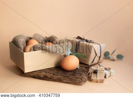Easter Eggs In Sustainable Box With Natural Canva Burlap Cloth And Eucalyptus Branch