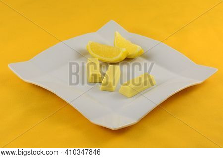 Lemon White Chocolate Wafer Candy Bars Snacks With Lemons On White Dessert Plate On Yellow Backgroun