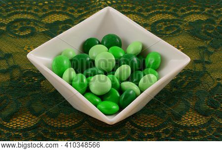 Green Candy Coated Dark Chocolate Mint Candy For Saint Patrick Day In White Candy Dish On Green Lace