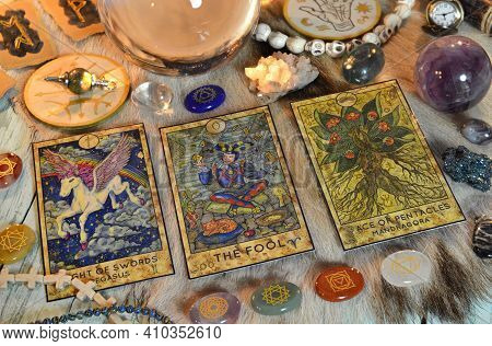 Fortune Telling Ritual With Chakras On Stones, Tarot Cards And Runes On Witch Table. Esoteric, Gothi