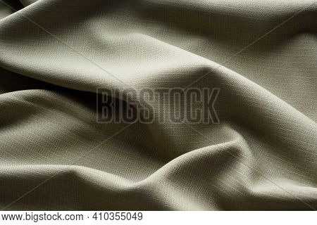 Abstract Background, Gray Luxurious Fabric Lies In Wavy Folds, Close-up. Elegant Design. Texture Fab