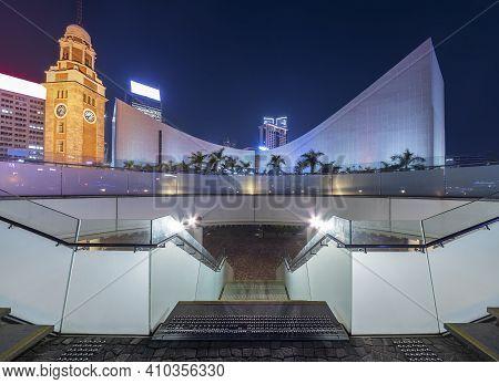 Seaside Promenade And Historical Landmark Clock Tower In Hong Kong City