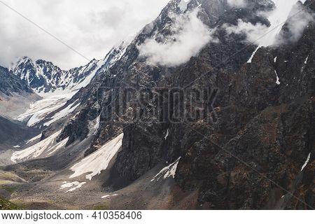 Atmospheric Minimalist Alpine Landscape With Massive Hanging Glacier On Giant Mountain. Big Glacier