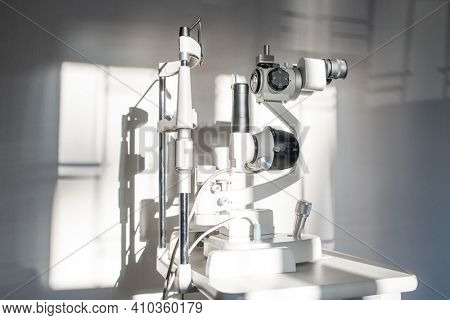 Ophthalmological diagnostic equipment on workplace of clinician inside medical office of contemporary ophthalmic clinics or hospital