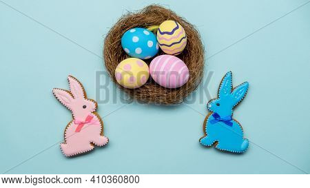 Easter Decoration. Holiday Composition. Festive Food Ornament. Gingerbread Bunny Cookie Color Painte