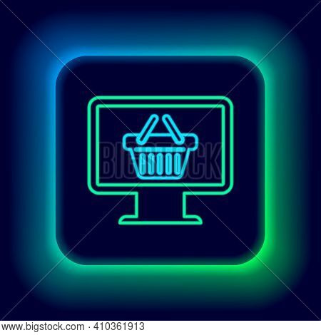 Glowing Neon Line Computer Monitor With Shopping Basket Icon Isolated On Black Background. Online Sh