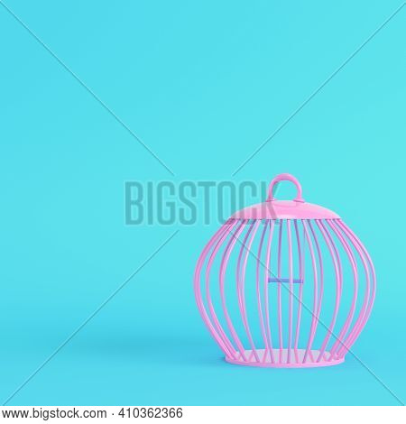 Pink Bird Cage On Bright Blue Background In Pastel Colors. Minimalism Concept. 3d Render