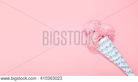 Chrysanthemums Bouquet Wrapped In A Sheet With Musical Notes On Pink Background With Copy Space. Hol