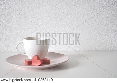 Cup Of Tea With Strawberry On White Background