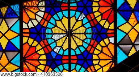 Colorful Stained Glass Window. Bright Geometric Shapes.