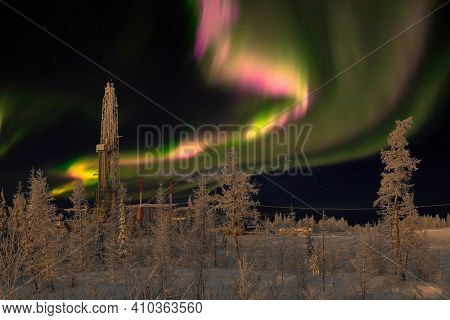 Winter Landscape At Polar Night With A Drilling Rig. Northern Oil And Gas Field. In The Background T
