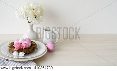 Easter Dinner. Festive Table. Holiday Celebration. Banquet Service. Pink Color Painted Eggs In Nest