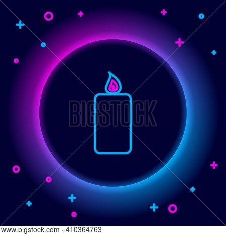 Glowing Neon Line Burning Candle Icon Isolated On Black Background. Old Fashioned Lit Candle. Cylind