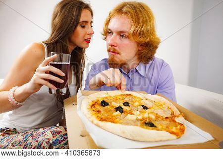 Young Couple Of Friends Spending Time Together Drinking Beer And Eating Italian Food, Delicious Pizz