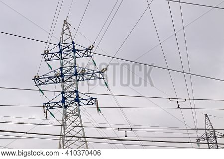 A Steel Lattice Tower Supporting An Overhead Power Line. The Top Of An Electric Transmission Tower,