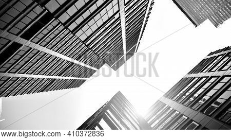 Bottom View Of Modern Skyscrapers In Business District Against Sky. Looking Up At Business Buildings