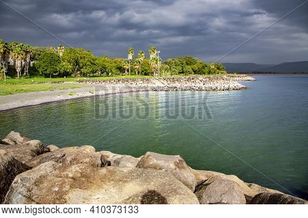 View Of The Sea Of Galilee Or Kinneret Lake With Rainy Clouds And Sun Beams. Northern Israel