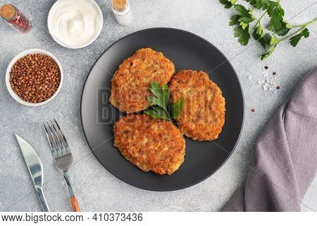 Buckwheat Cutlets With Cheese And Parsley On A Plate. Healthy Diet Food Copy Space, Top View.