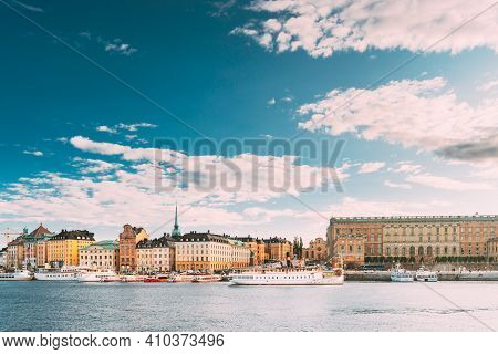 Stockholm, Sweden. Touristic Boat Floating Near Famous Embankment In Old Town Gamla Stan In Summer E