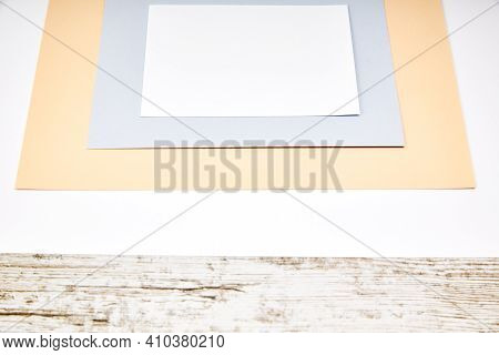 Colored Paper Sheets With Copy Space On A Wooden Table. Publicity Concept