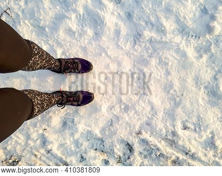 View From Above On Woman Standing In Running Tights And Shoes In Snow Ready To Start Running Outdoor