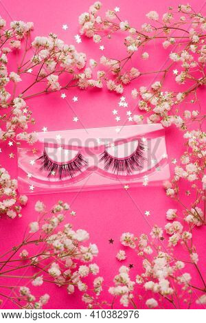 False Eyelashes . False Eyelashes On A Pink Background. Layout Of The Beauty Industry. Beauty And Fa