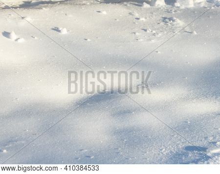 Abstract And Textured White, Shiny And Glittery Snow Background In Winter