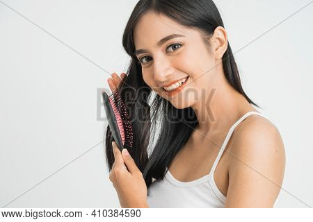 Beautiful Young Asian Female - Combing Her Long Straight Hair