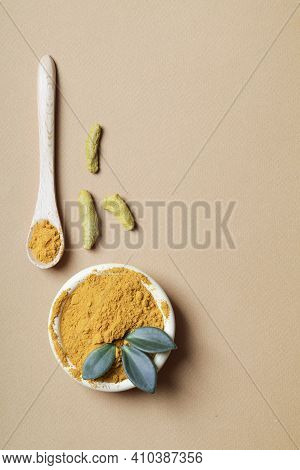 Health Care Lifestyle Concept. Curcuma Longa Or Turmeric Powder In Bowl With Green Leaf,wooden Spoon