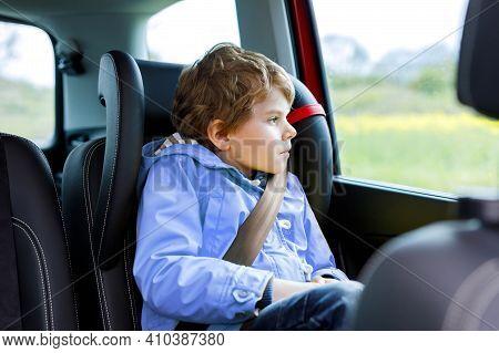 Tired Preschool Kid Boy Sitting In Car During Traffic Jam. Sad Little School Child In Safety Car Sea