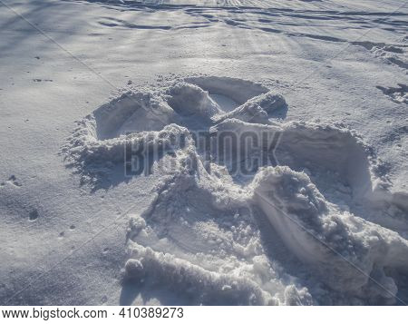 Snow Angel Design Made In Fresh, Deep Snow, By Lying On Back And Moving Arms Up And Down, And Legs F