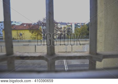 Prison Window With Bars, View Into The Inner Courtyard Of A Prison