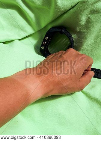 Tanned Womans Hand With Sports Watch Taken Off With A Clear And Visible Tan Line From Wearing Smartw