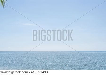 Beautiful Sky Over Sea With Sunlight. Tranquil Sea Harmony Of Water Surface. Sunny Sky And Blue Ocea