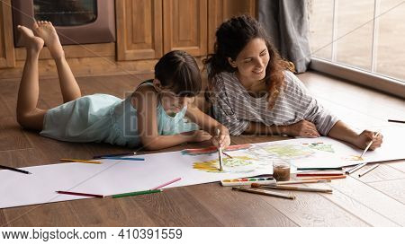 Happy Latino Mom And Daughter Painting Together