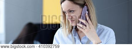 Woman Talking On Cell Phone And Looking At Laptop. Remote Advisory Assistance Concept