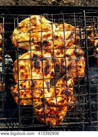 Close Up Of Bbq Chicken. Grilling Juicy Chicken Meat On Home Barbecue Charcoal Grill. Weber Type Sma