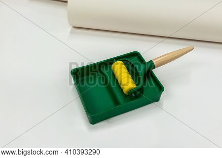Yellow And Green Brush Roller Paint Tray Isolated On White Background. Kid Toy.