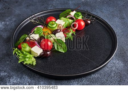 Fresh Greek Salad With Tomato, Cucumber, Bel Pepper , Olives And Feta Cheese On Black Plate, Close U