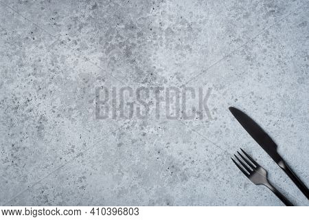 Black Cutlery Cutlery On A Gray Table. Top View. Copy Space For Text.
