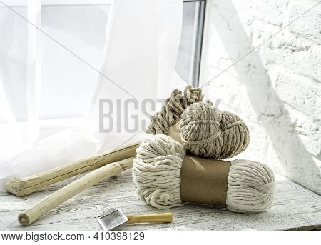 On A Wooden Background Are Two Skewers Of Rope For Macrame. Weaving Macrame. Accessories In The Form