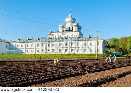 Veliky Novgorod, Russia - May 12. 2018. St. Varlaam Monastery And Laborers Working In The Monastery