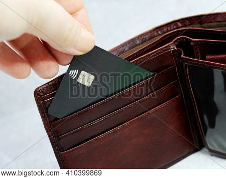 Brown Wallet With Black Credit Card So Close