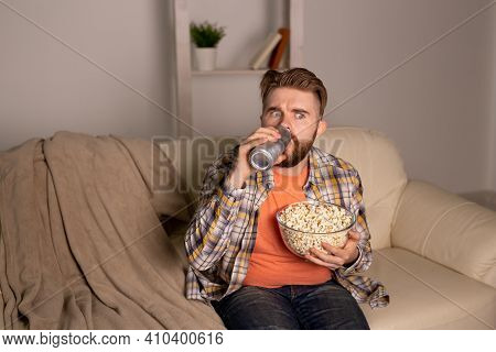 Bearded Man Watching Film Or Sport Games Tv Eating Popcorn In House At Night. Cinema, Championship A