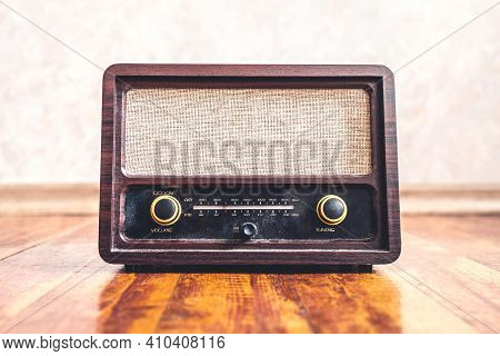 Retro Vintage Radio. Music Nostalgia With Old 60s Style Song Player. Dusty Speaker And Receiver On W