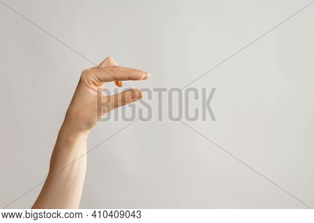 Hand Gestures. Very Small Size, Something Small Concept, Show Small Size With Your Thumb And Index F