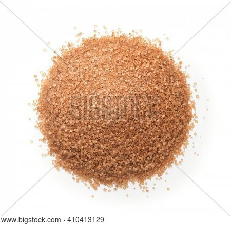 Top view of natural unrefined granulated brown sugar isolated on white