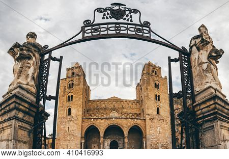 Cefalu, Italy - March 6, 2020: Entrance gate to the Cathedral Basilica of Cefalu or Duomo di Cefalu in the old town of coastal city Cefalu, Sicily, Italy